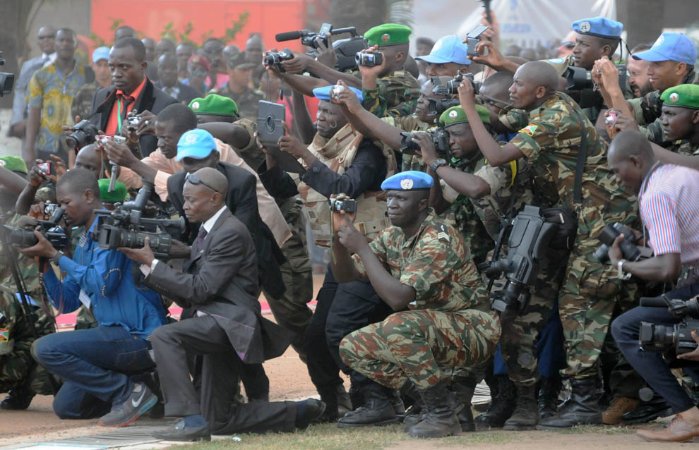 BANGUI, CENTRAL AFRICAN REPUBLIC - Members of the media and military take photos of CAR's president and UN officials at a Sept. 15, 2014 ceremony to mark the formal start of the United Nations peacekeeping mission. MICHELLE SHEPHARD / TORONTO STAR MICHELLE SHEPHARD/Toronto Star