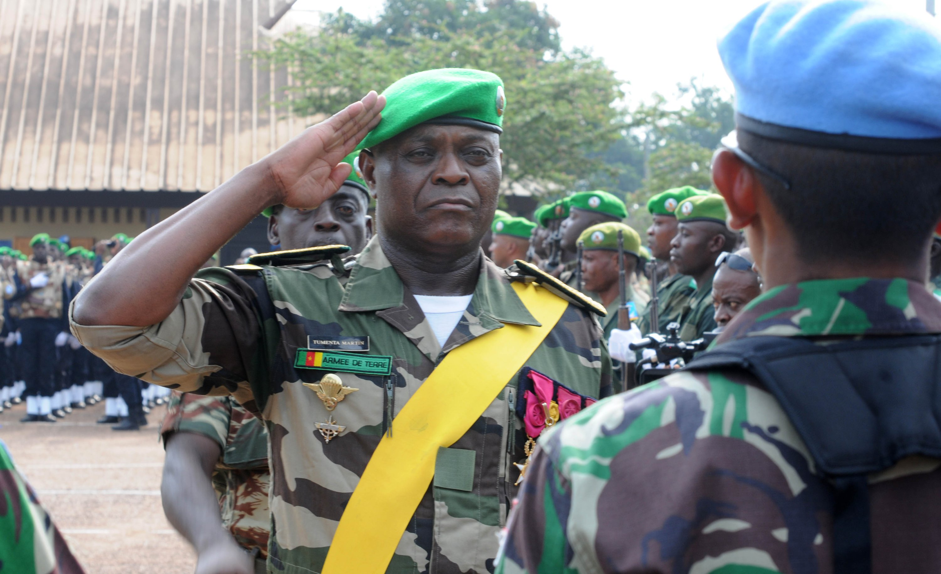 """BANGUI, CENTRAL AFRICAN REPUBLIC - Cameroonian General Martin Tumenta at the Sept. 14, 2014 """"re-hat"""" ceremony where he trades his African Union beret for the blue of the United Nations, which took over the peacekeeping mission. MICHELLE SHEPHARD / TORONTO STAR MICHELLE SHEPHARD/Toronto Star"""